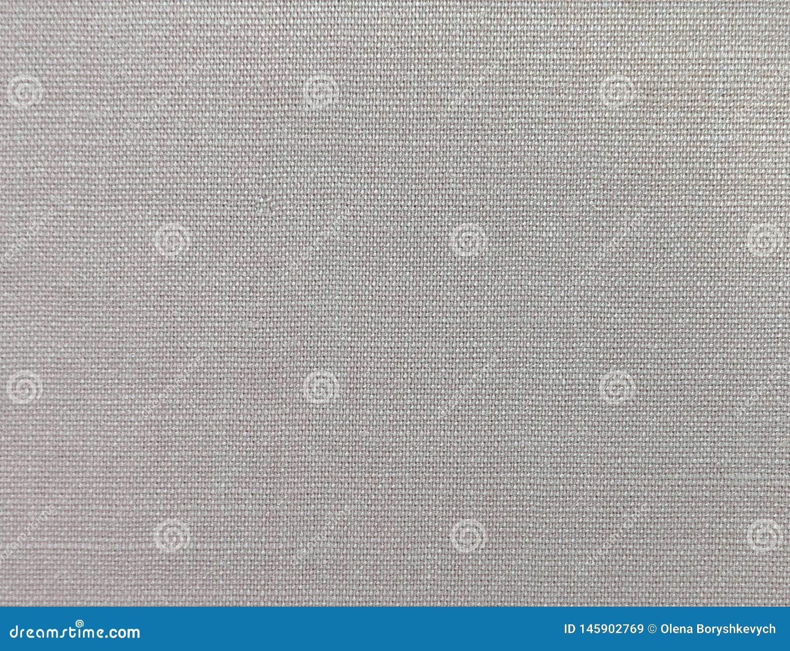 Fondo texturizado de la materia textil natural gris