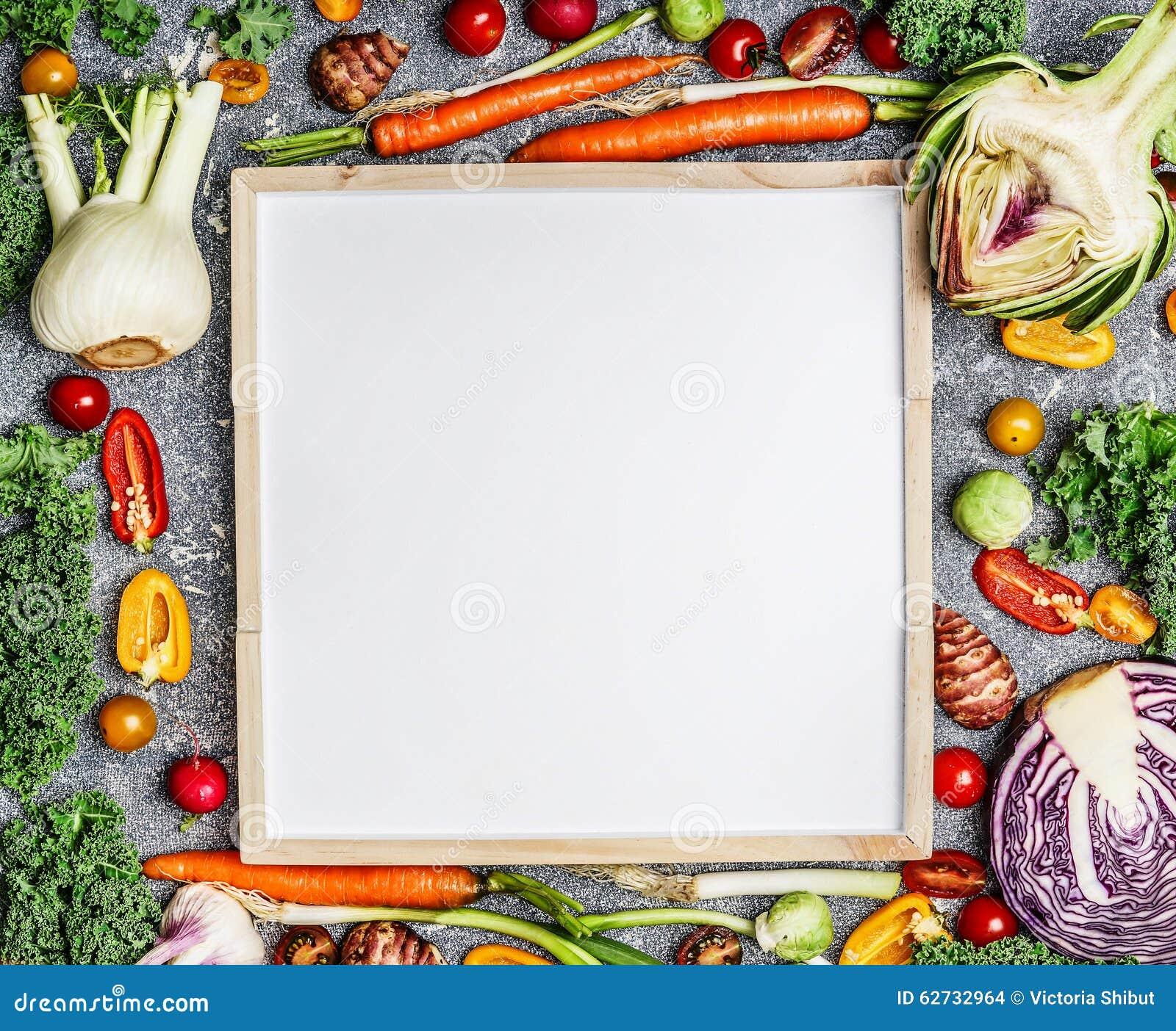 Fondo vegetariano di nutrizione dell alimento, di salute e di dieta con varietà di verdure fresche dell azienda agricola intorno