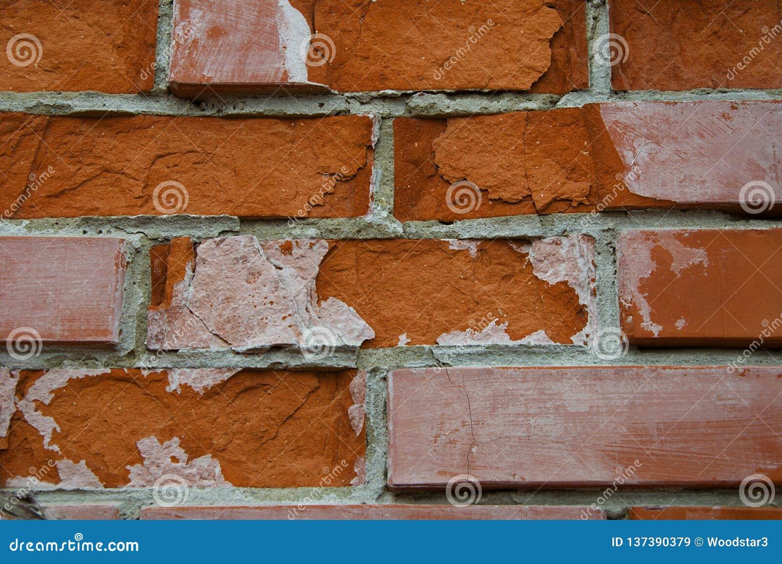 Fondo y textura del ladrillo Roto, rasguñado y agrietado, ladrillo en la pared