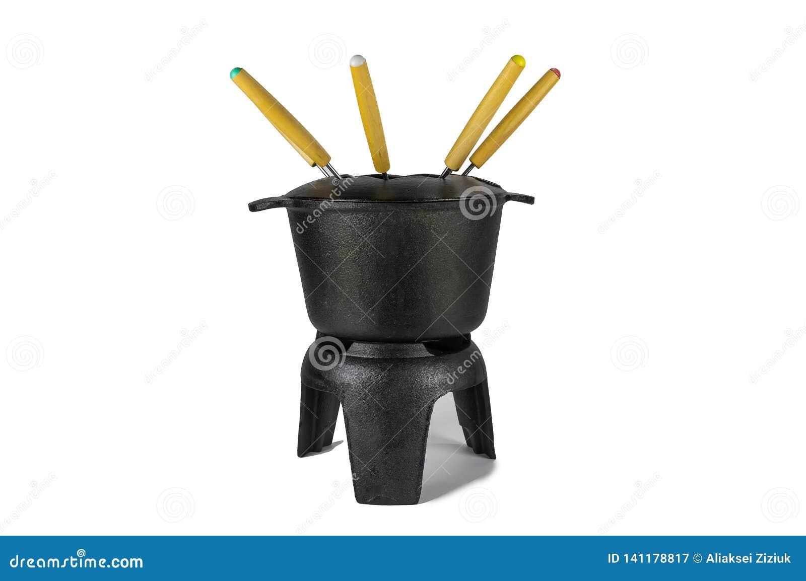 Fonduesvinjärnet som är svart, med mång--färgade gafflar