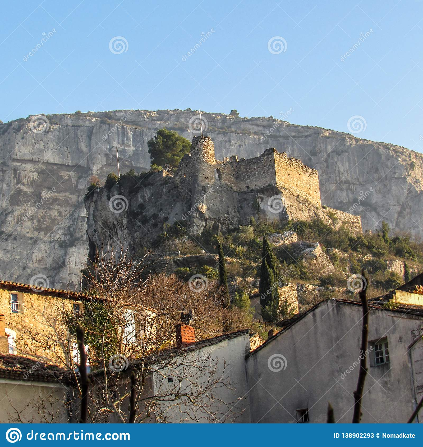 Streets of the Fontaine de Vaucluse with a castle ruins, Provence France