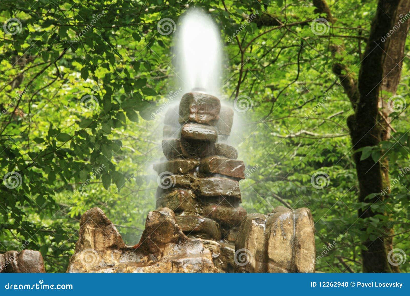 Fontaine en pierre en bois