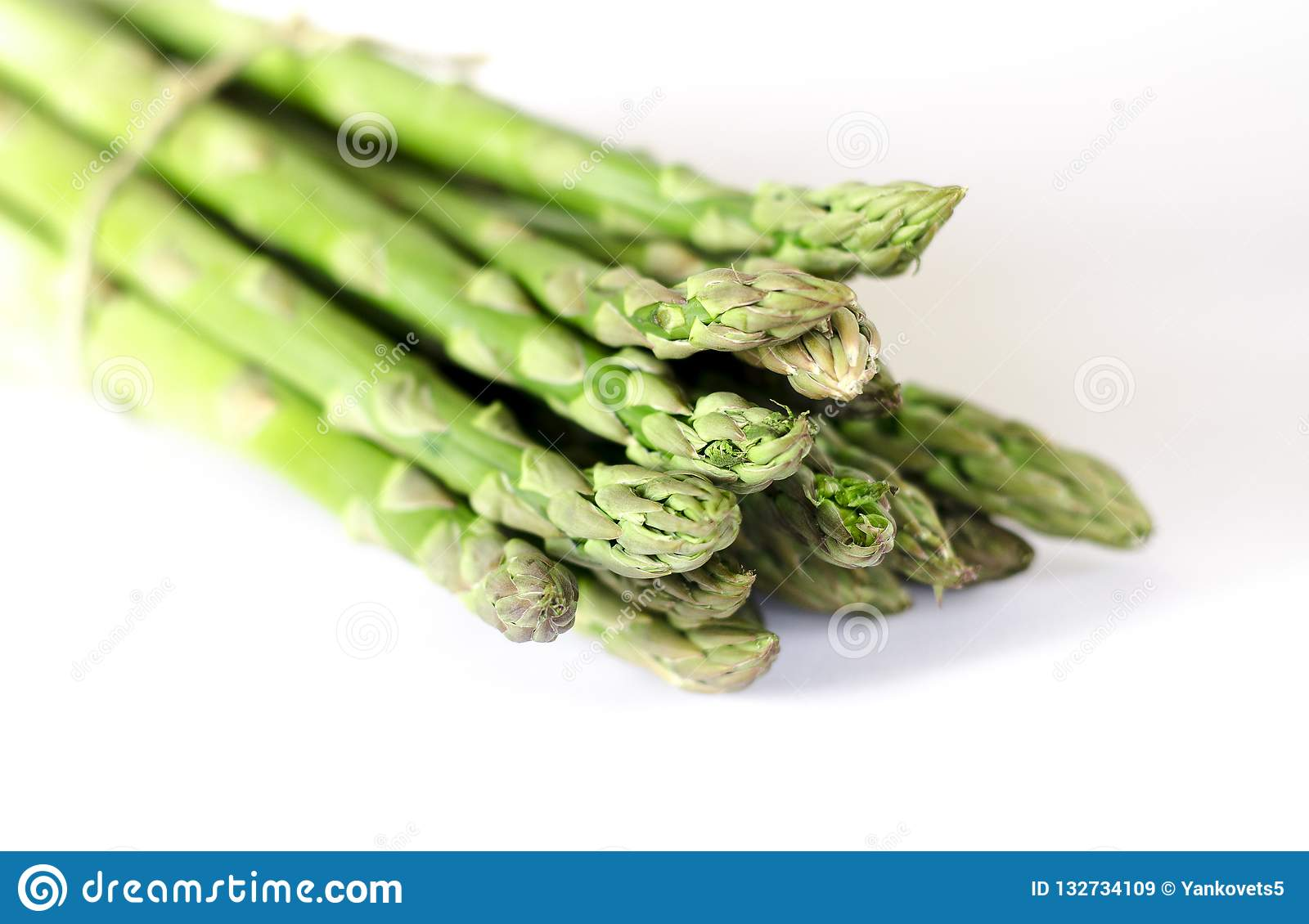 Food background asparagus flat lay pattern. bunch of fresh green asparagus on white background, top view