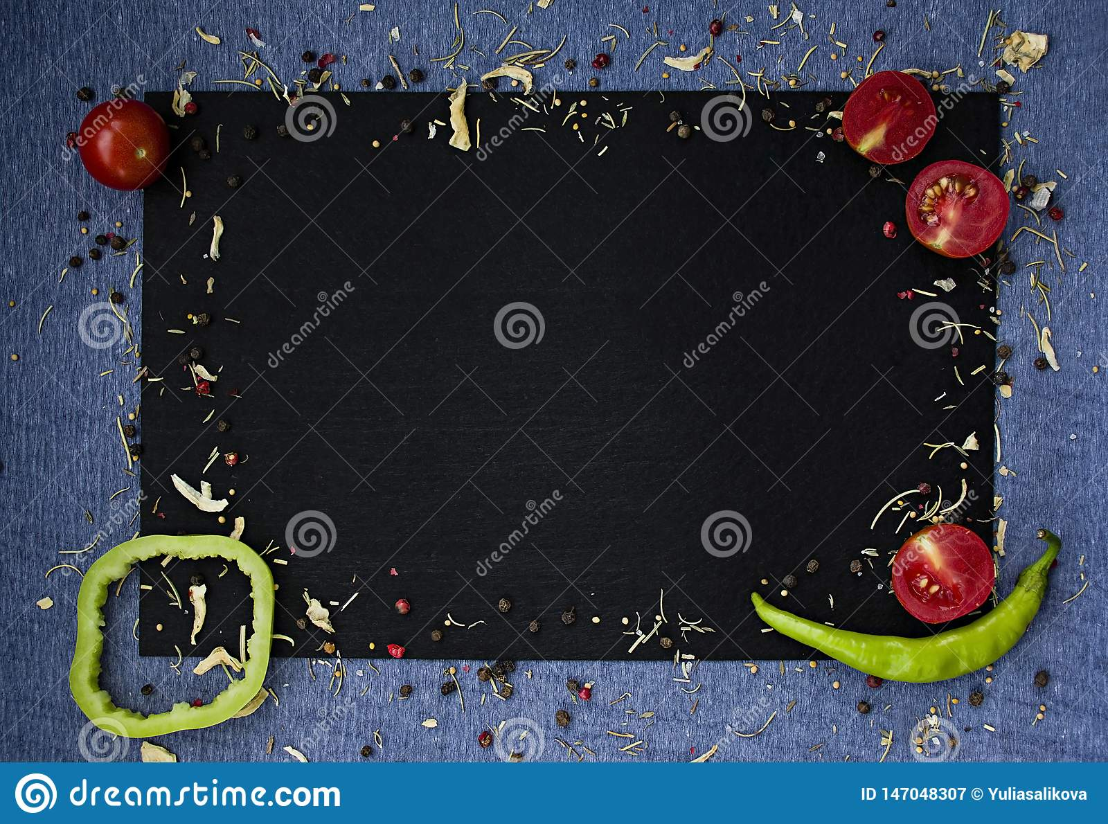 Food background. Fresh farmer vegetables at dark beton table. Space for text