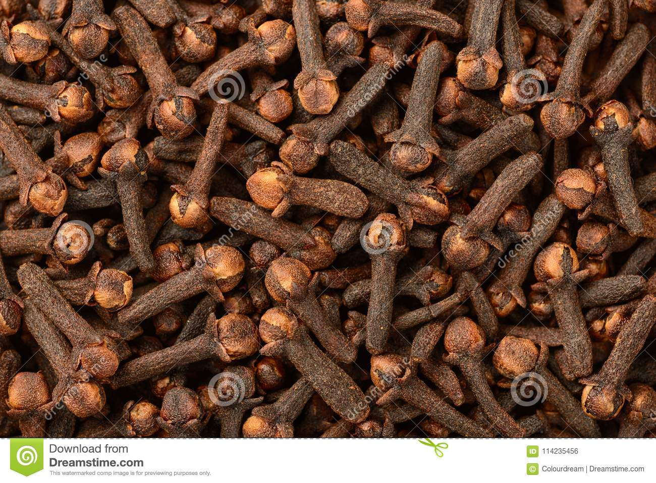 Food background of dried cloves, top view