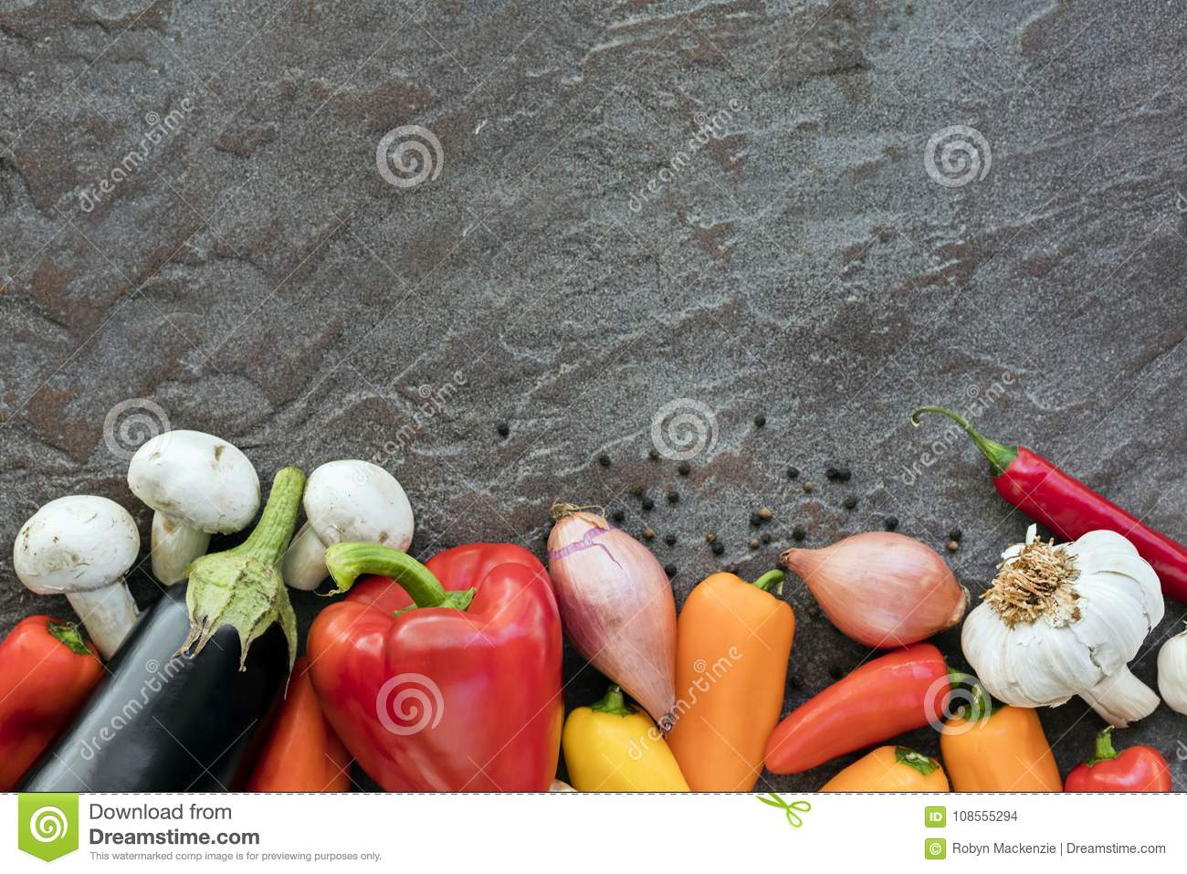Food Background Vegetables on Slate Top view