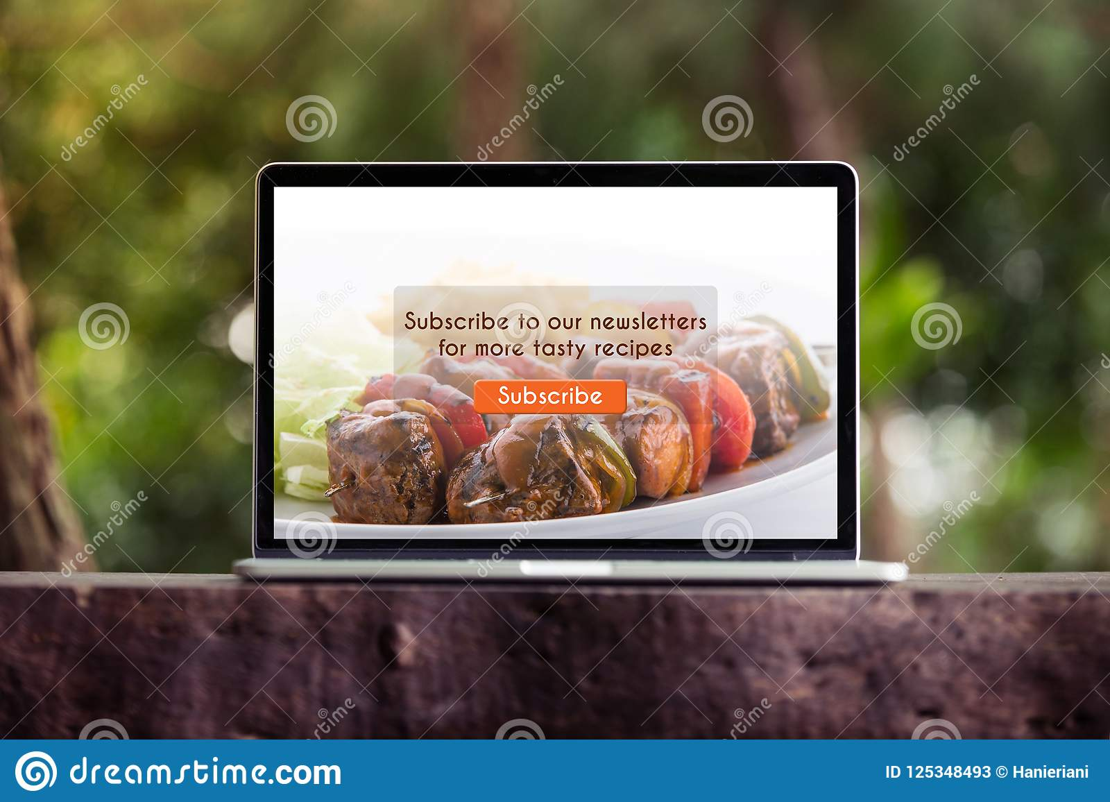 Food blog subscribtion on laptop / computer screen concept