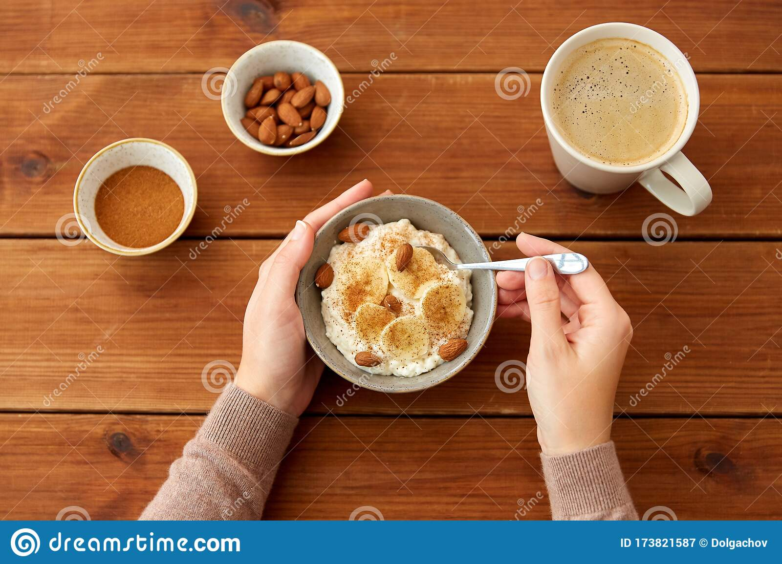 Hands With Oatmeal Breakfast And Cup Of Coffee Stock Image Image Of Coffee Rustic 173821587