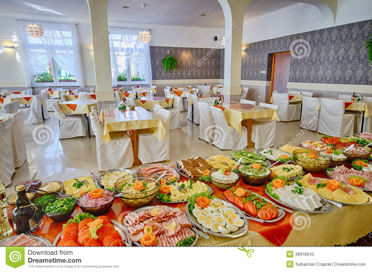 Platters and dishes of Food set up for a large catered dinner or lunch ...