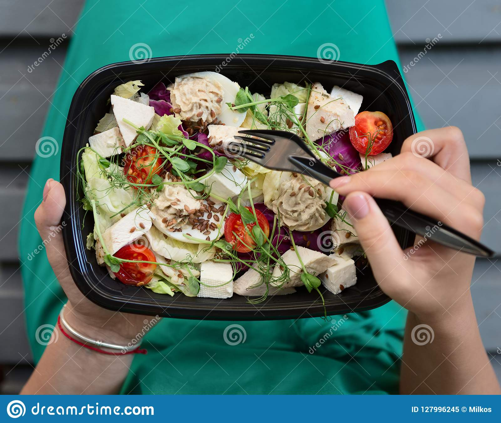 Woman eating healthy food at lunch time