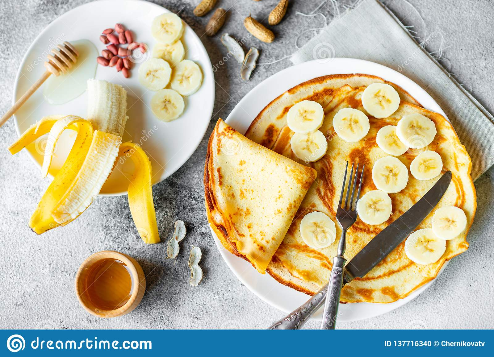 Food, dessert, pastries, pancake, pie. Tasty beautiful pancakes with banana and honey