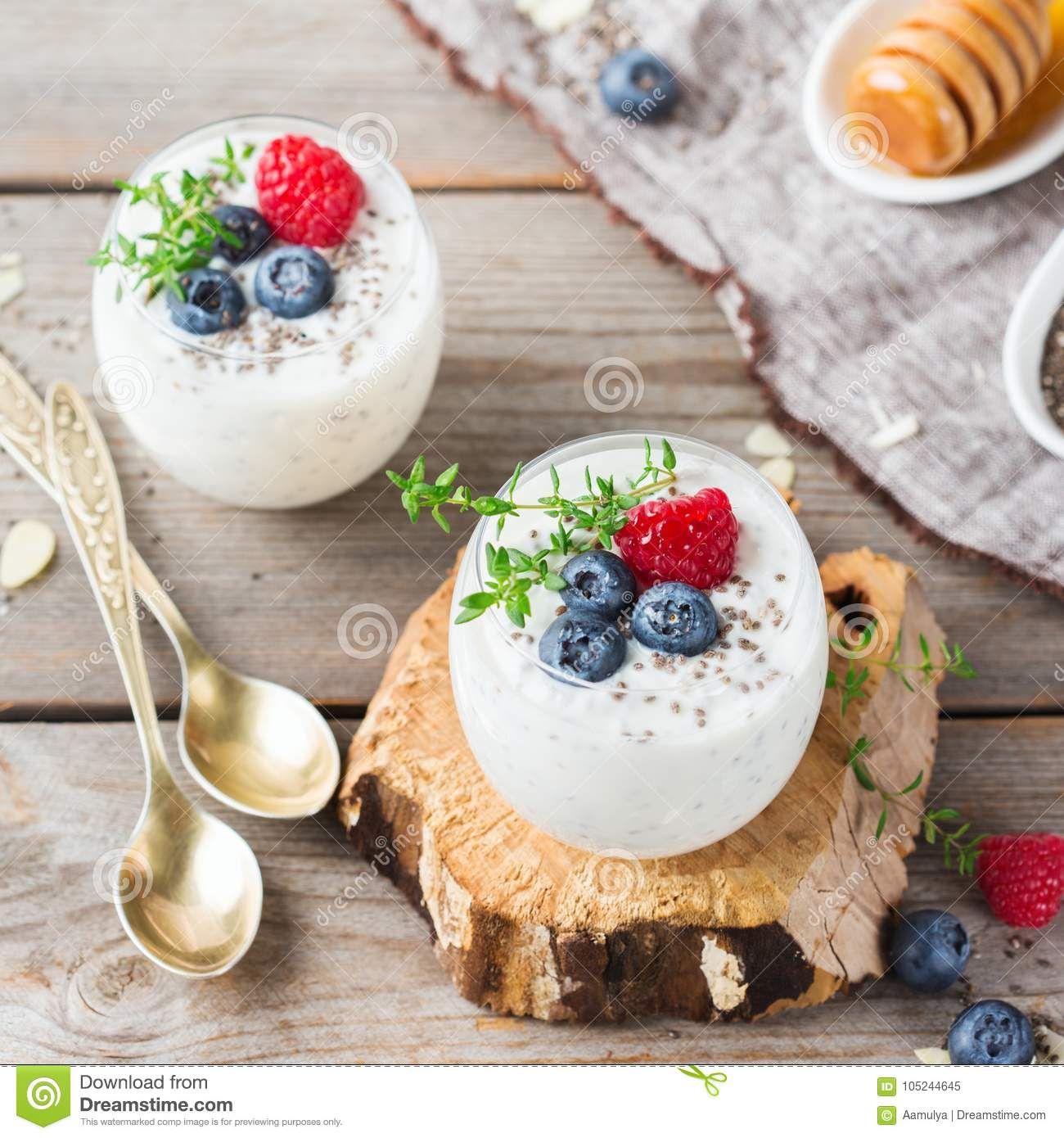 Healthy Vegan White Chia Pudding With Berries And Green Thyme Stock