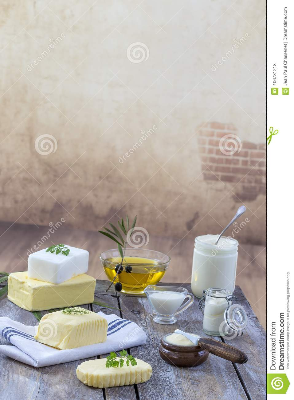 Food Fats and oil : set of dairy product and oil and animal fats on a wooden background