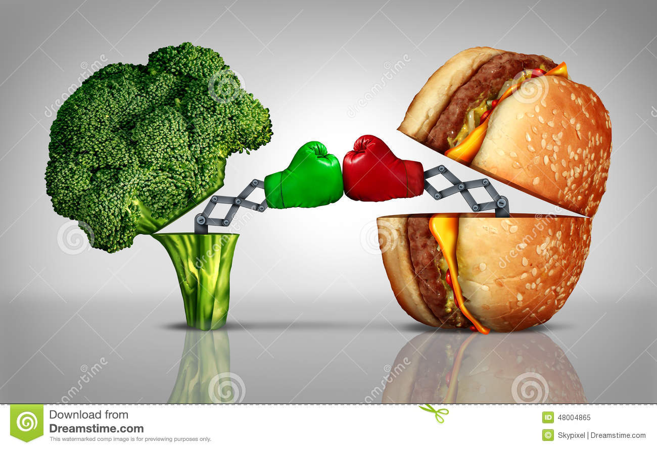 Food fight nutrition concept as a fresh healthy broccoli fighting an ...
