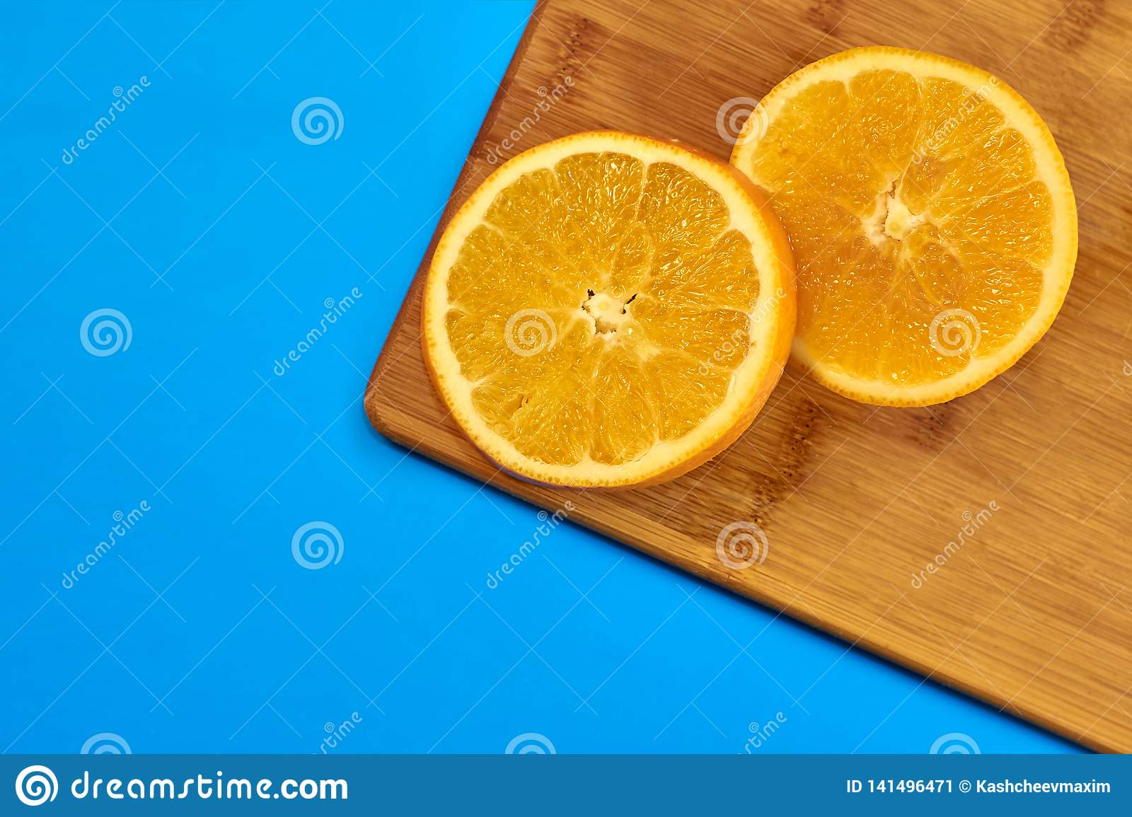 Food for fitness, healthy lifestyle, flat lay with fresh fat-burning fruits, slices of orange on the kitchen cutting board
