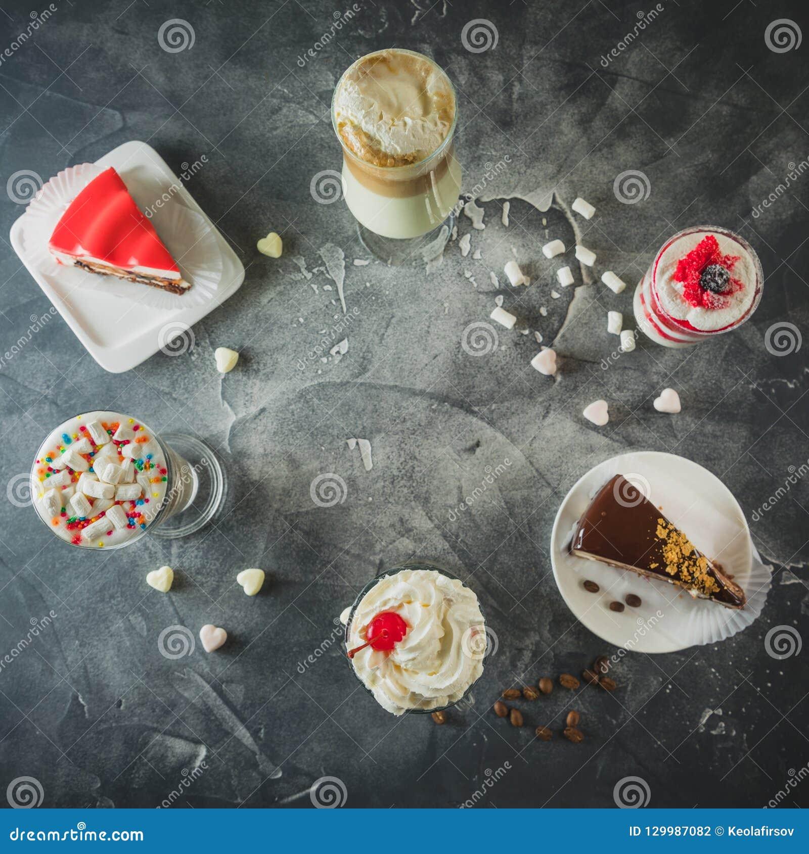 Food frame with milkshake drinks and desserts. Milkshakes and cake. Flat lay