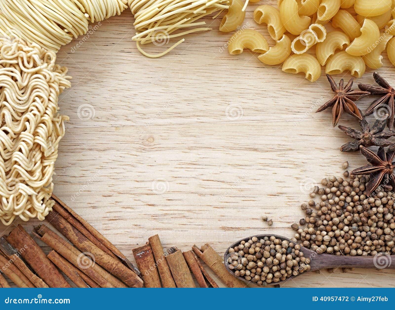 Food frame noodle peppercorn macaroni design on wooden background