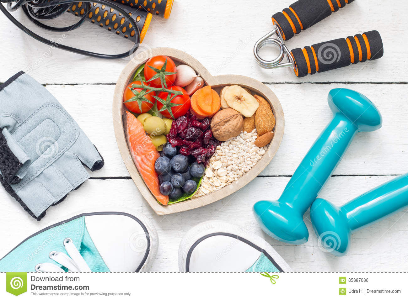 Food in heart and dumbbells fitness abstract healthy lifestyle concept