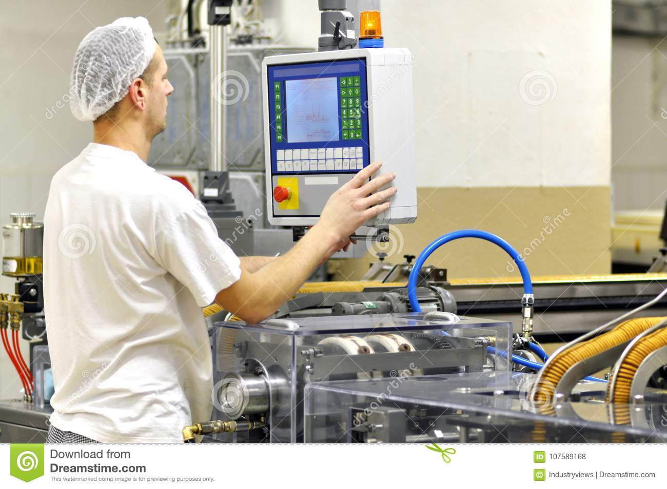 Food industry - biscuit production in a factory on a conveyor be