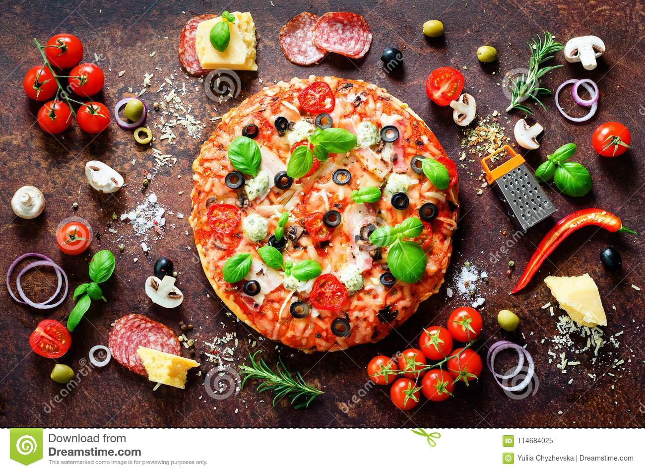 Food ingredients and spices for cooking delicious italian pizza. Mushrooms, tomatoes, cheese, onion, oil, pepper, salt