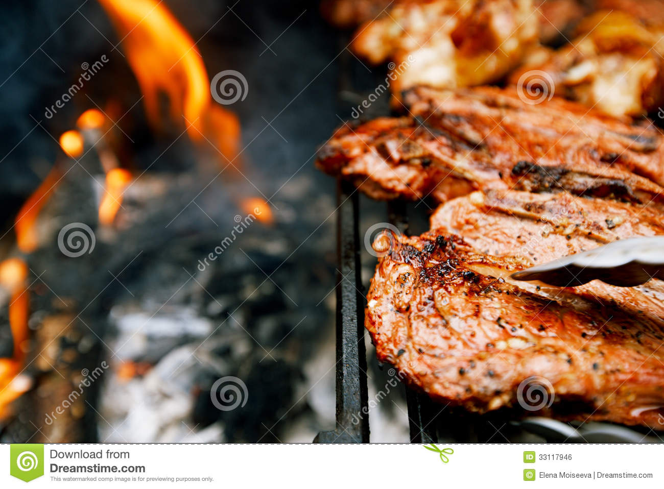 Food meat - chicken and beef on party summer barbecue grill
