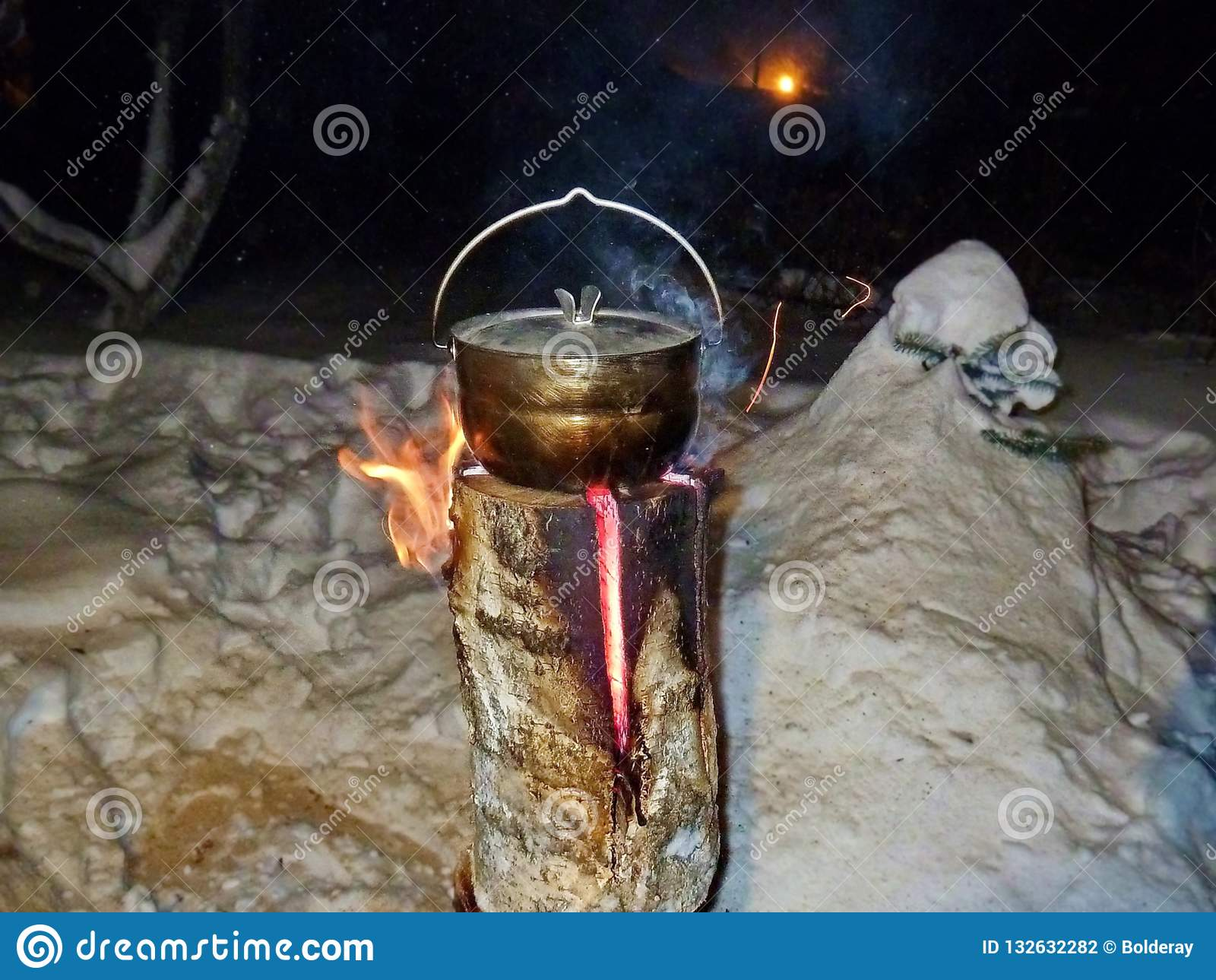food in the pot is prepared on the taiga candles stock photo