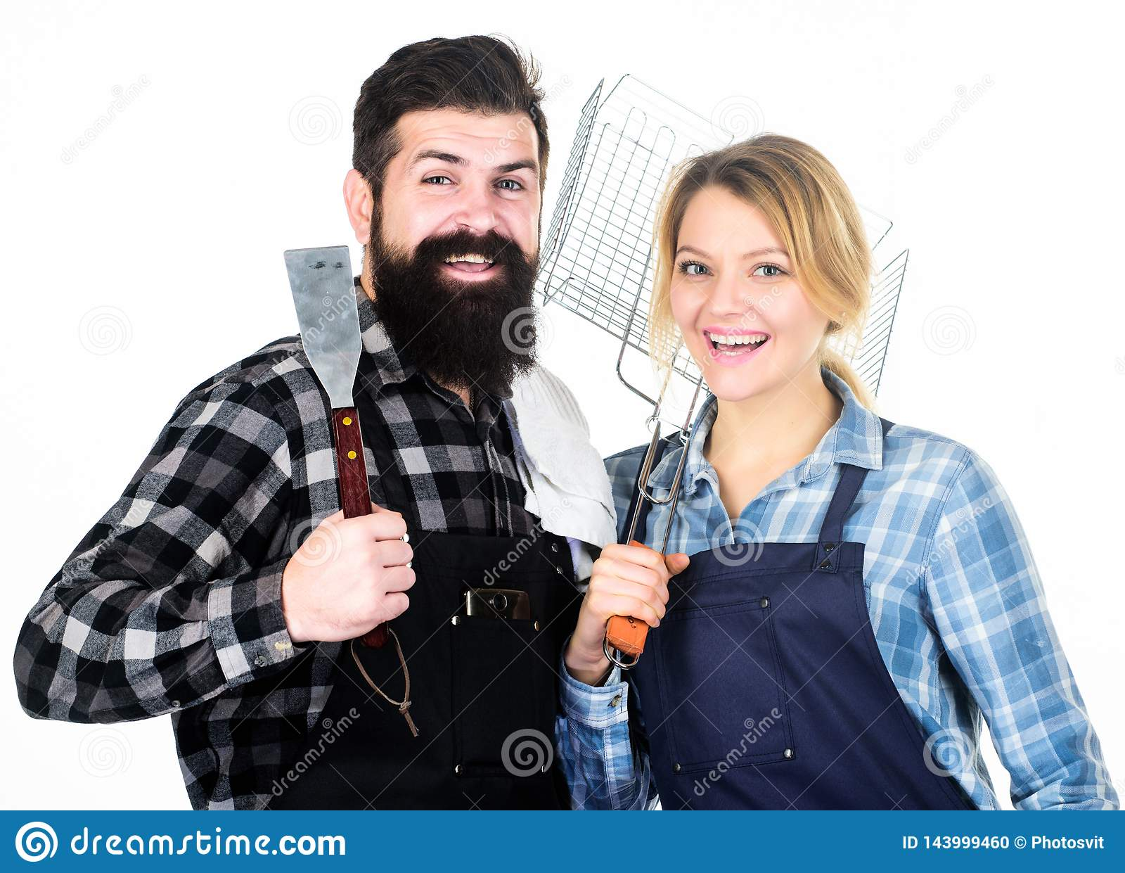 Food preparation. Family weekend. Man bearded hipster and girl. Preparation and culinary. Tools for roasting meat