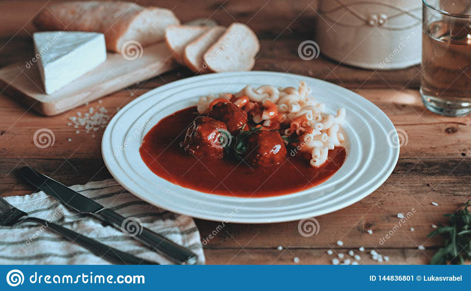 Food styling tomato sauce with pasta on the wooden planks