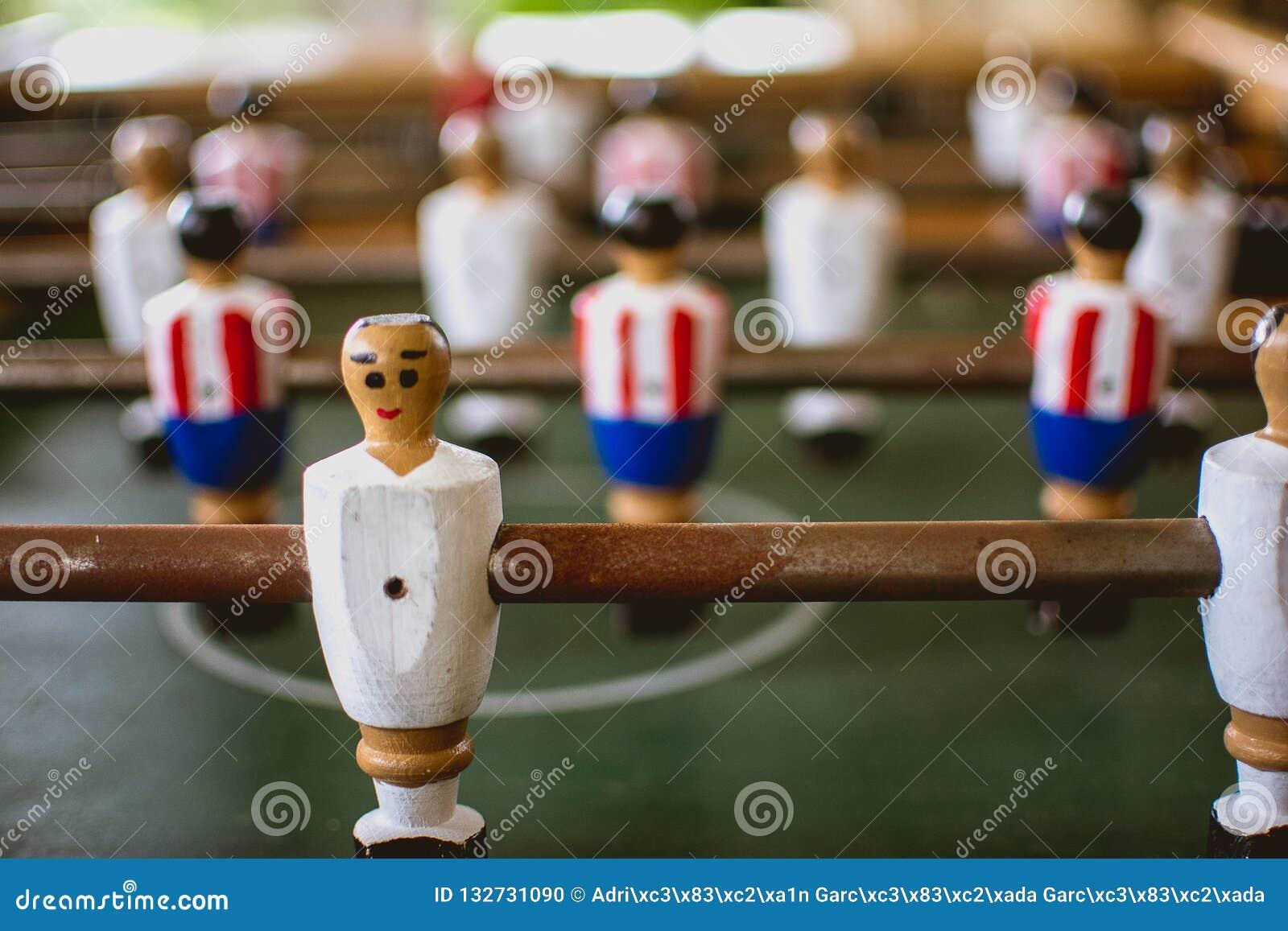 Foosballspelers in foosballspel