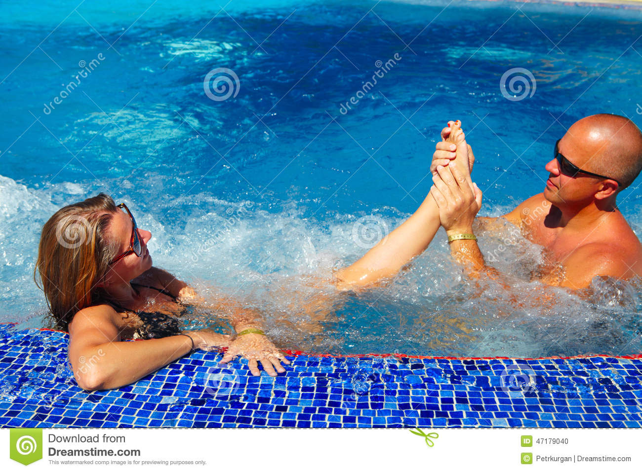Foot massage in jacuzzi stock photo. Image of adult, person - 47179040