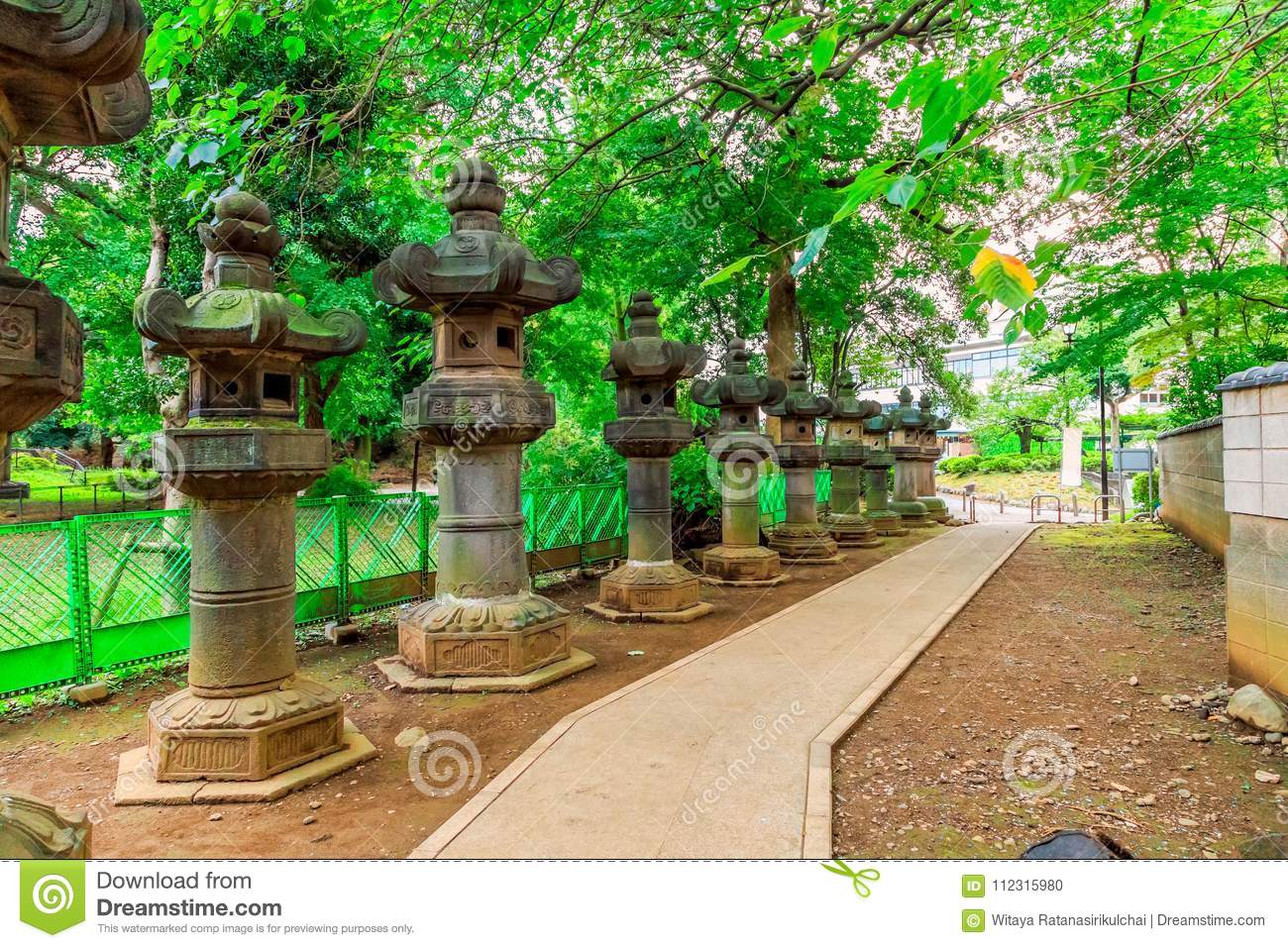 Foot Path In The Park With Japanese Style Stone Lanterns Stock Photo