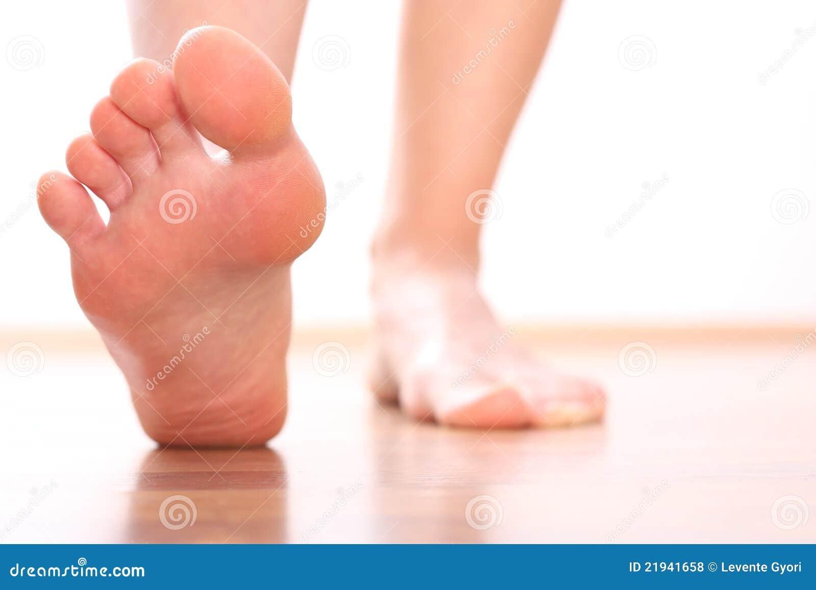 Foot stepping closeup woman legs