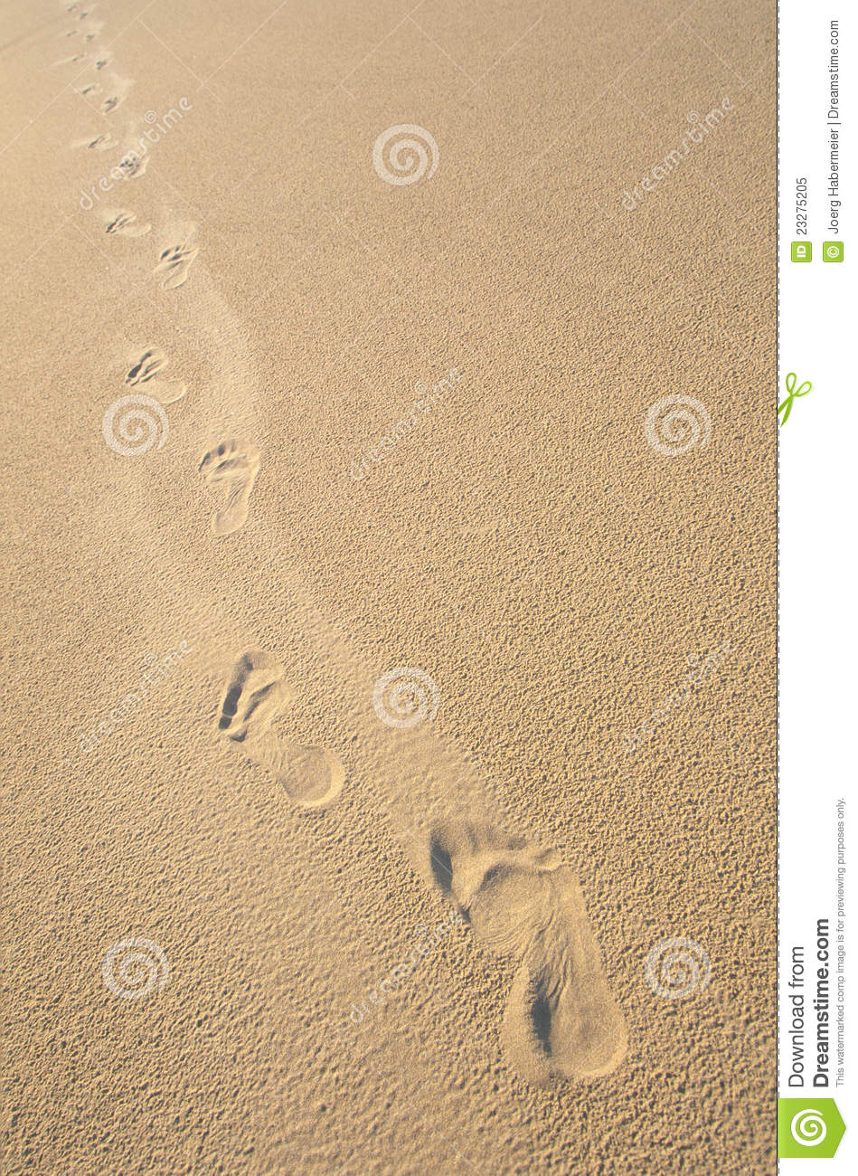 Foot Steps In Smooth, Beige Sand Royalty Free Stock Photo - Image: 23275205