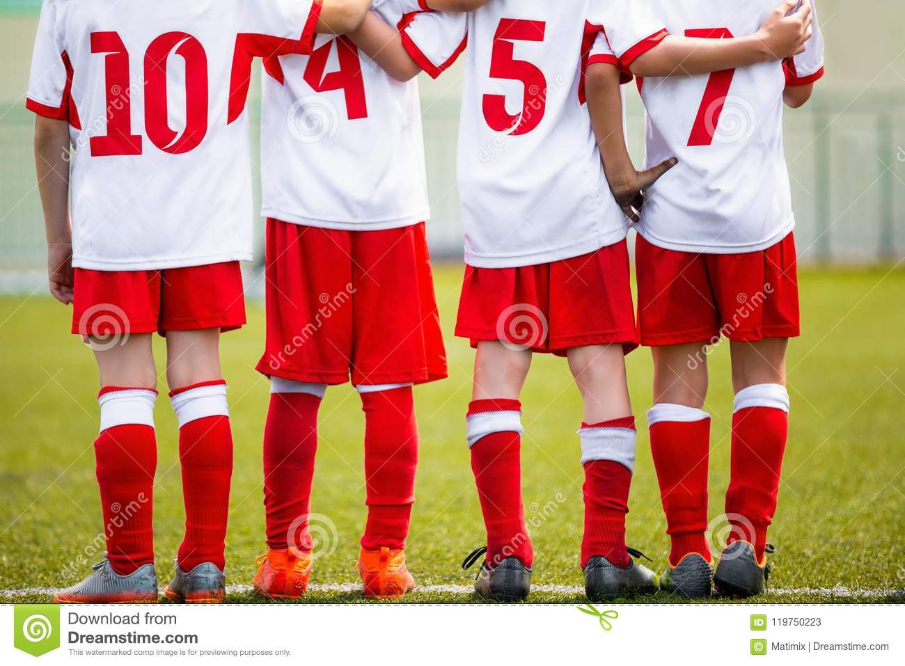 Football children team. Kids soccer substitute players standing together on a row