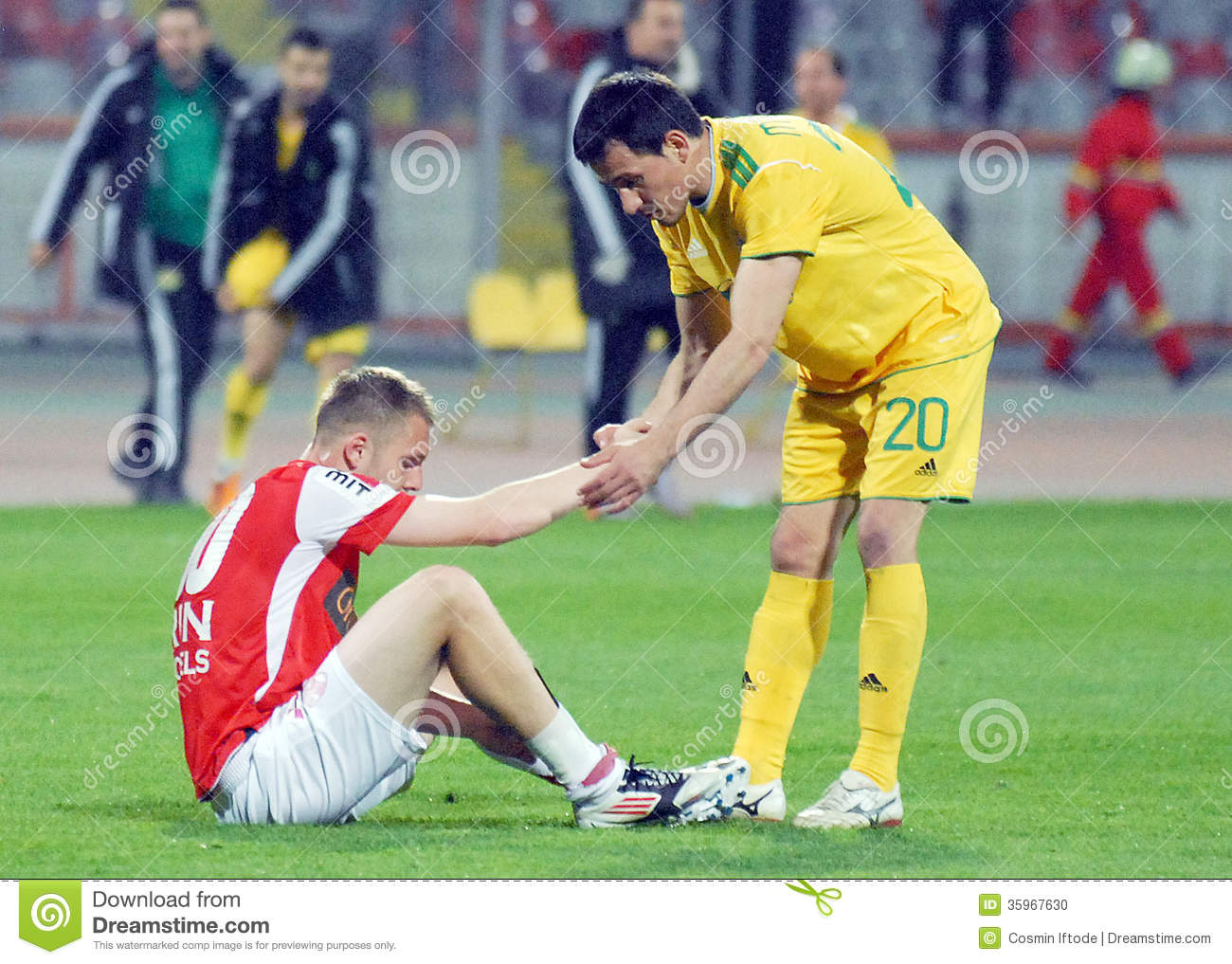 Football players pictured in a fair play gesture at the end of the ...