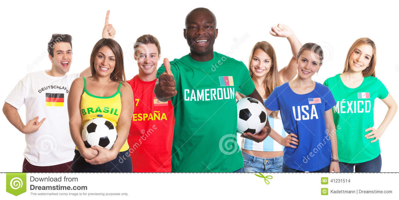 Football fan from Cameroon showing thumb with ball and other fans