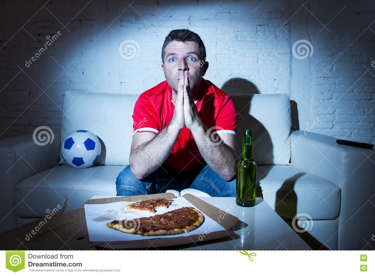 Football Fan Man Watching Game On Tv In Team Jersey Nervous