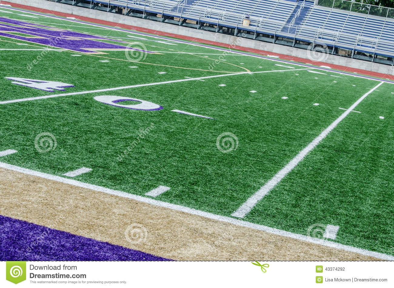 Small Soccer Field In Backyard : Football field in a small town at the 40 yard line with empty stands