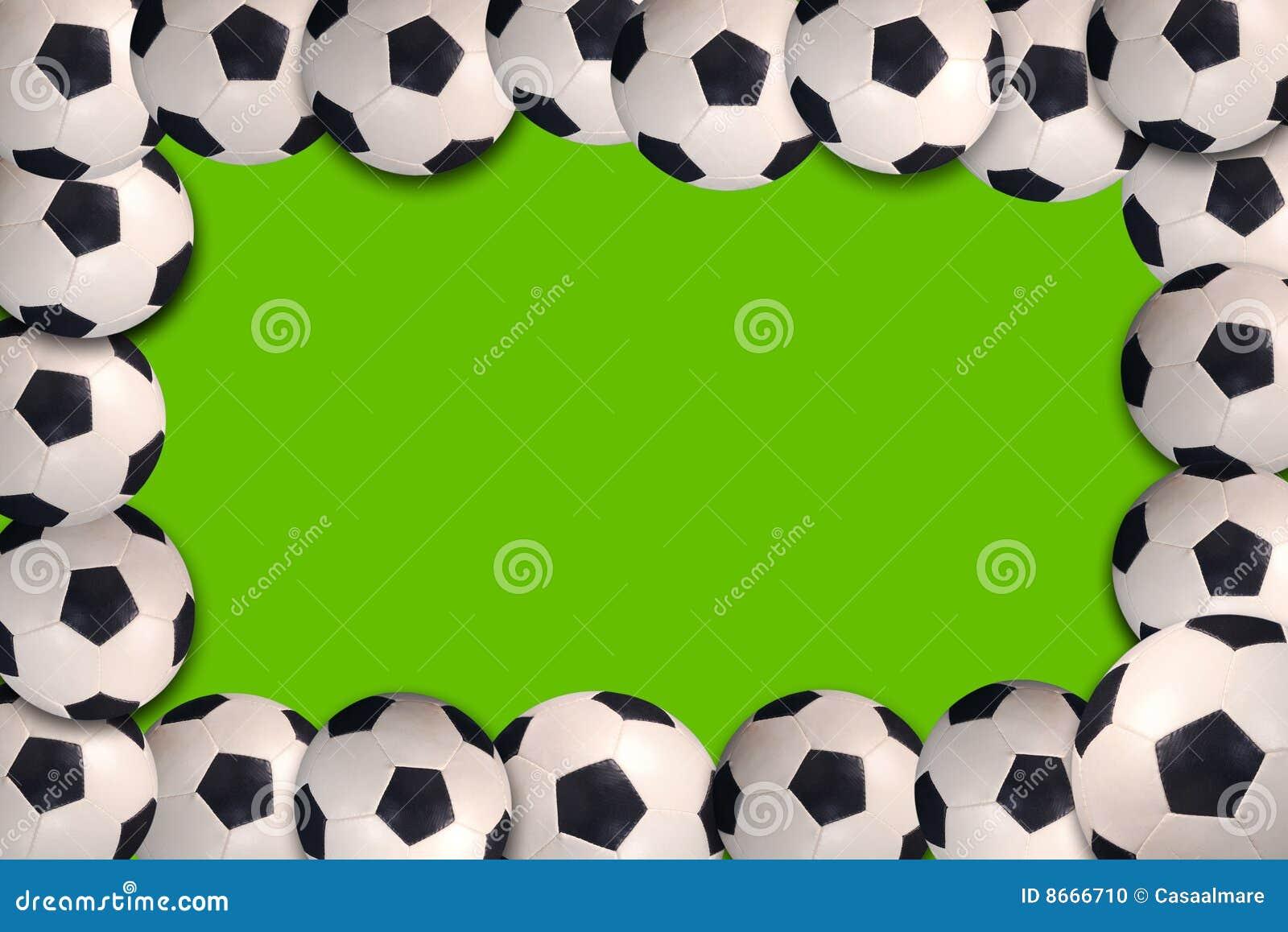Soccer balls on green ...