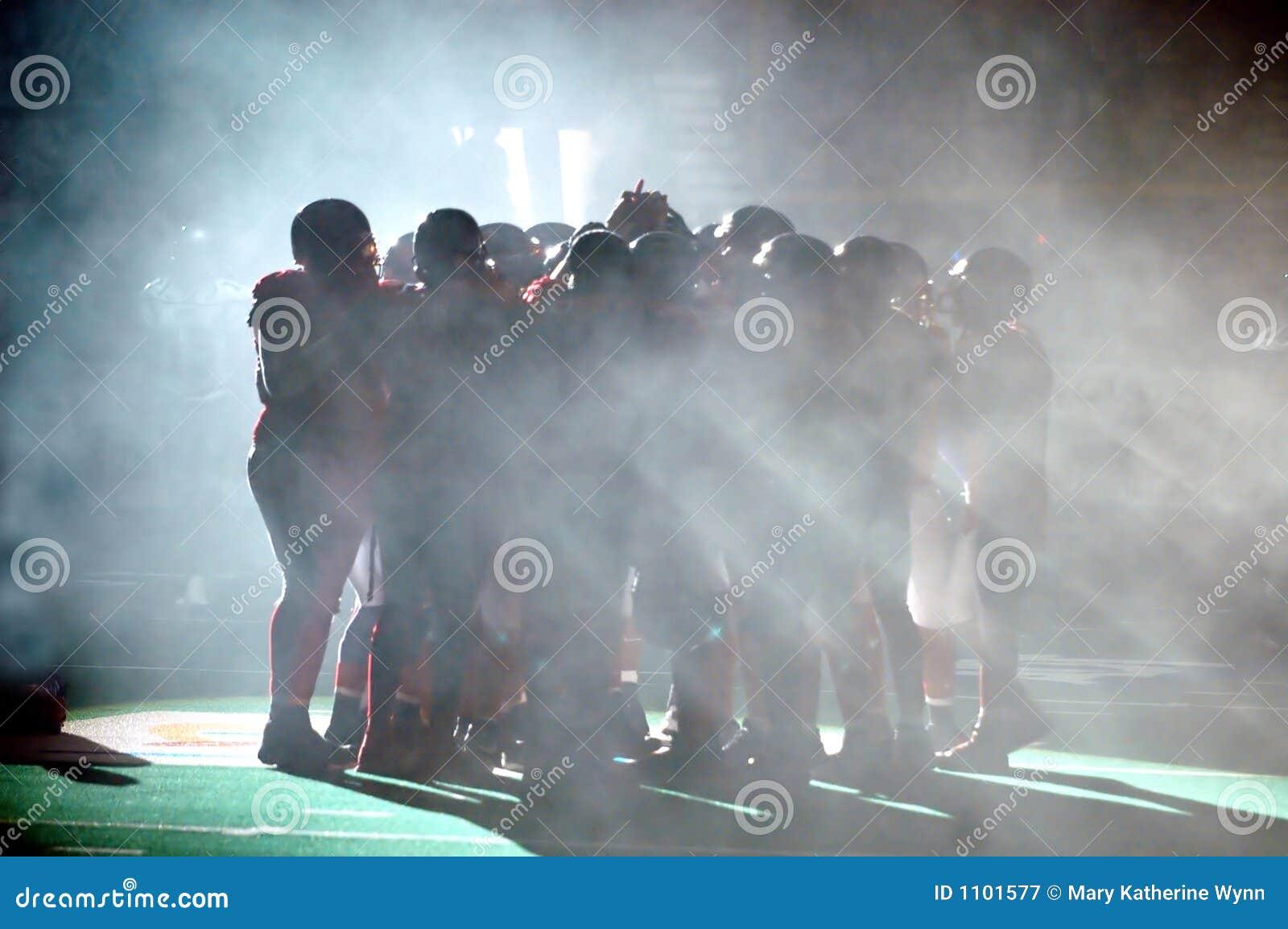 Football Huddle in fog