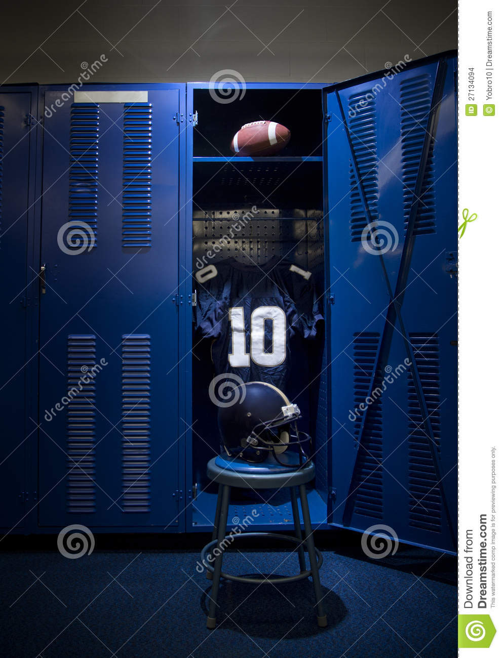 An open locker with a jersey, helmet and ball in a authentic football ...