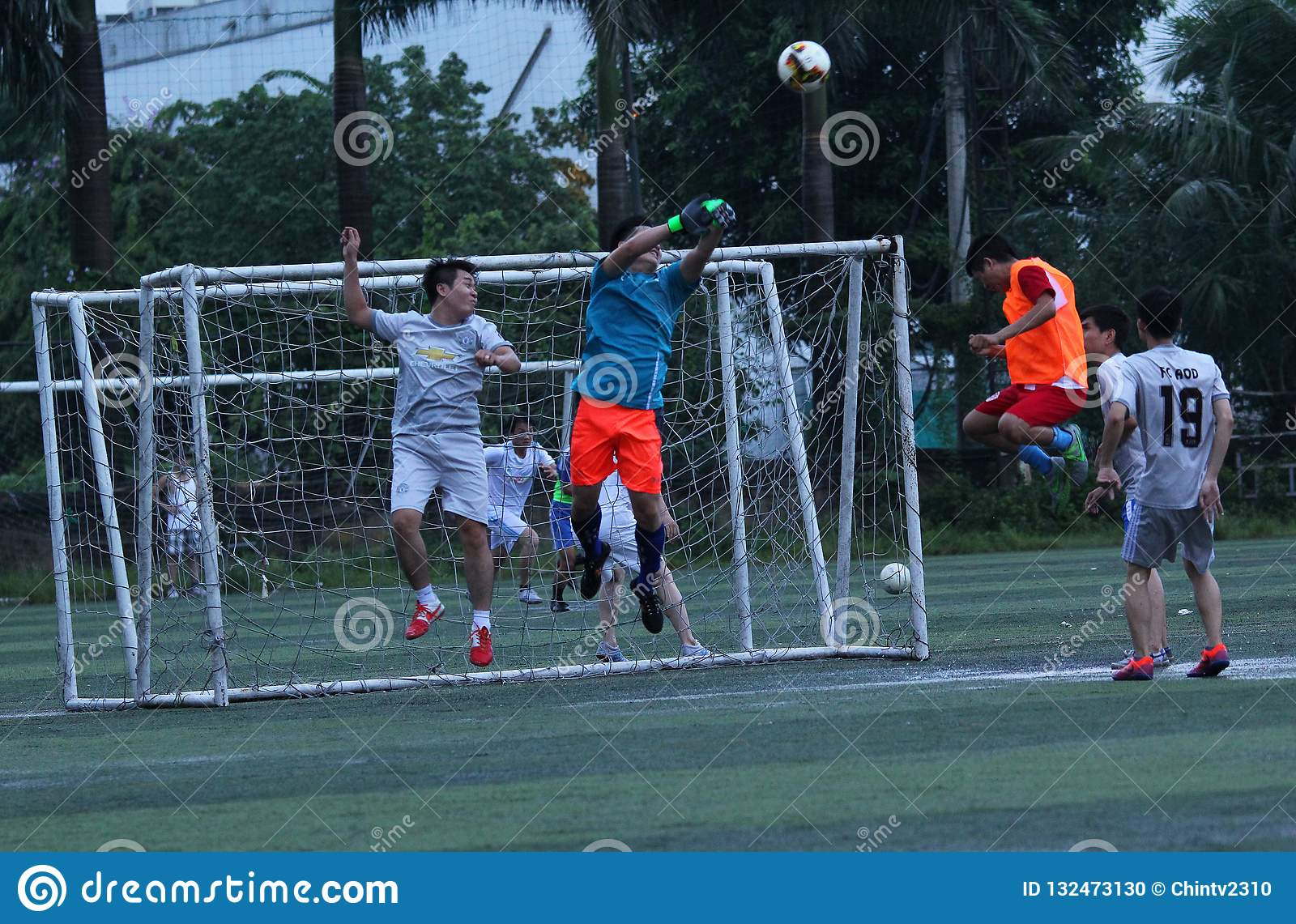 Football match - goal keeper face to face with the ball at Hanoi, Viet nam - July, 29,2018