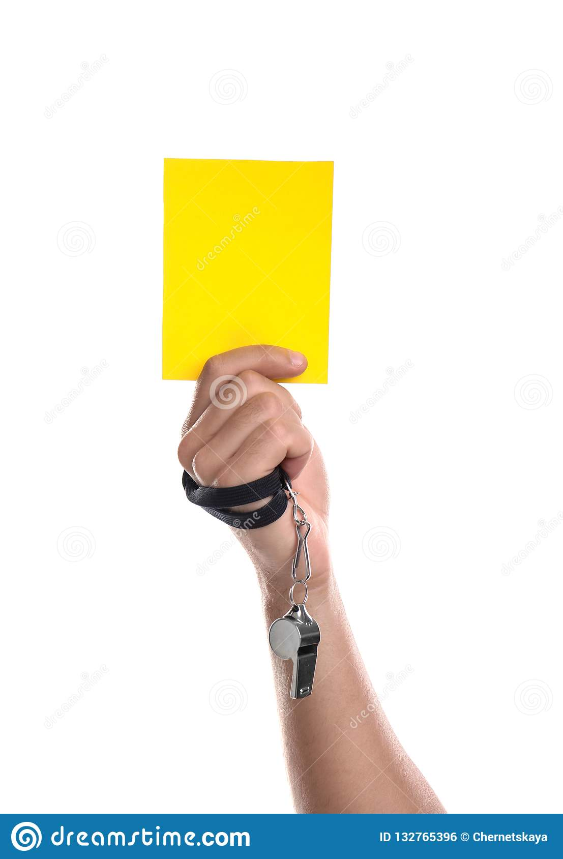 Football referee with whistle holding yellow card on white background