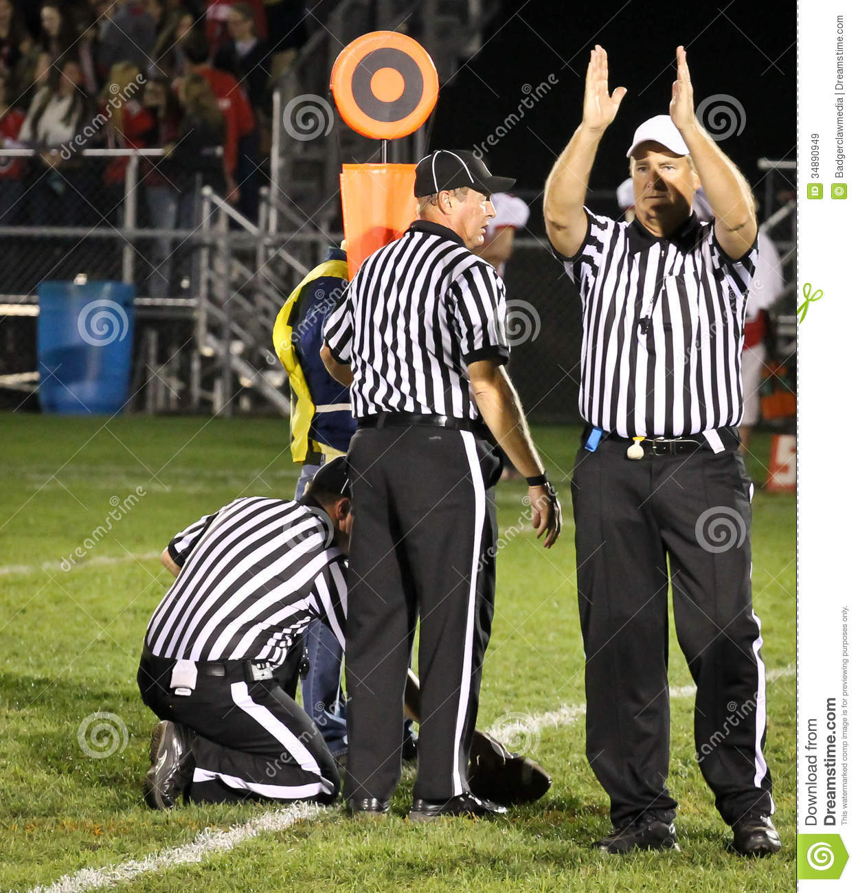 football referees gesturing fourth down and short editorial stock image