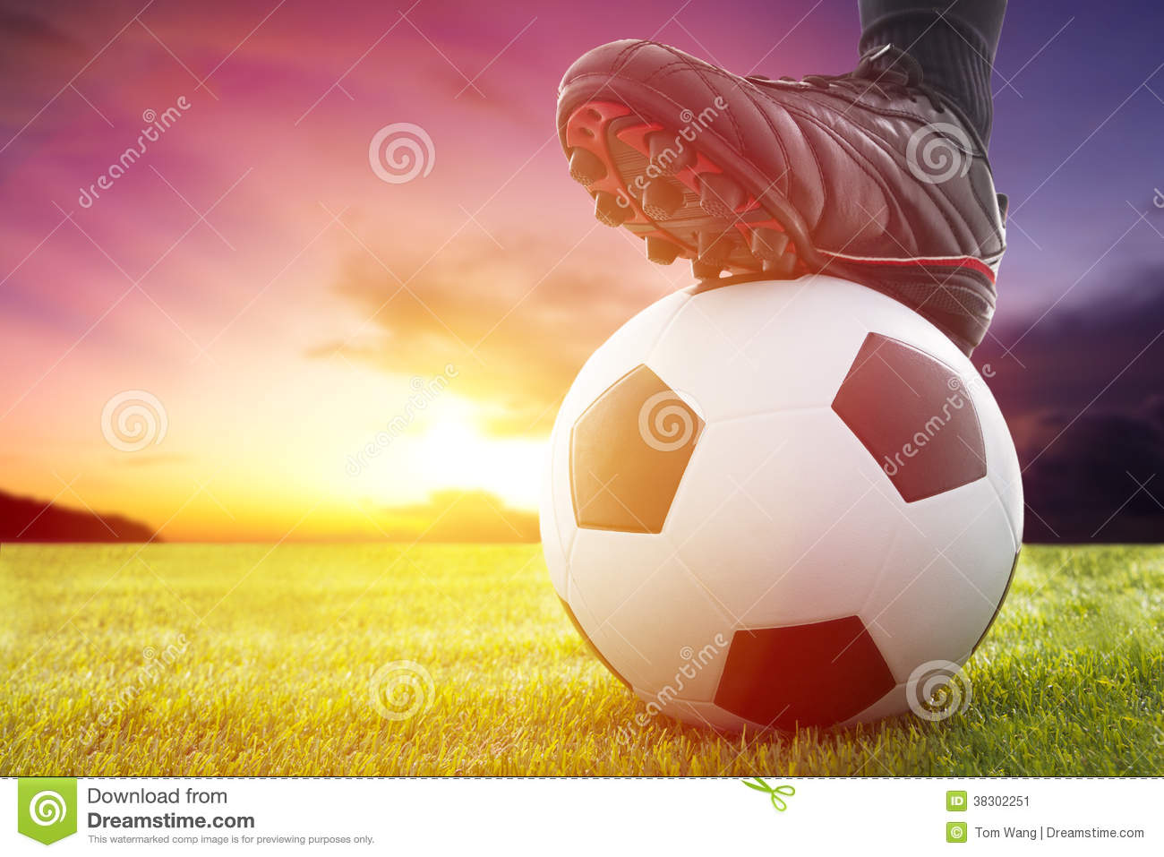 Football Or Soccer Ball At The Kickoff Of A Game With Sunset Stock ...
