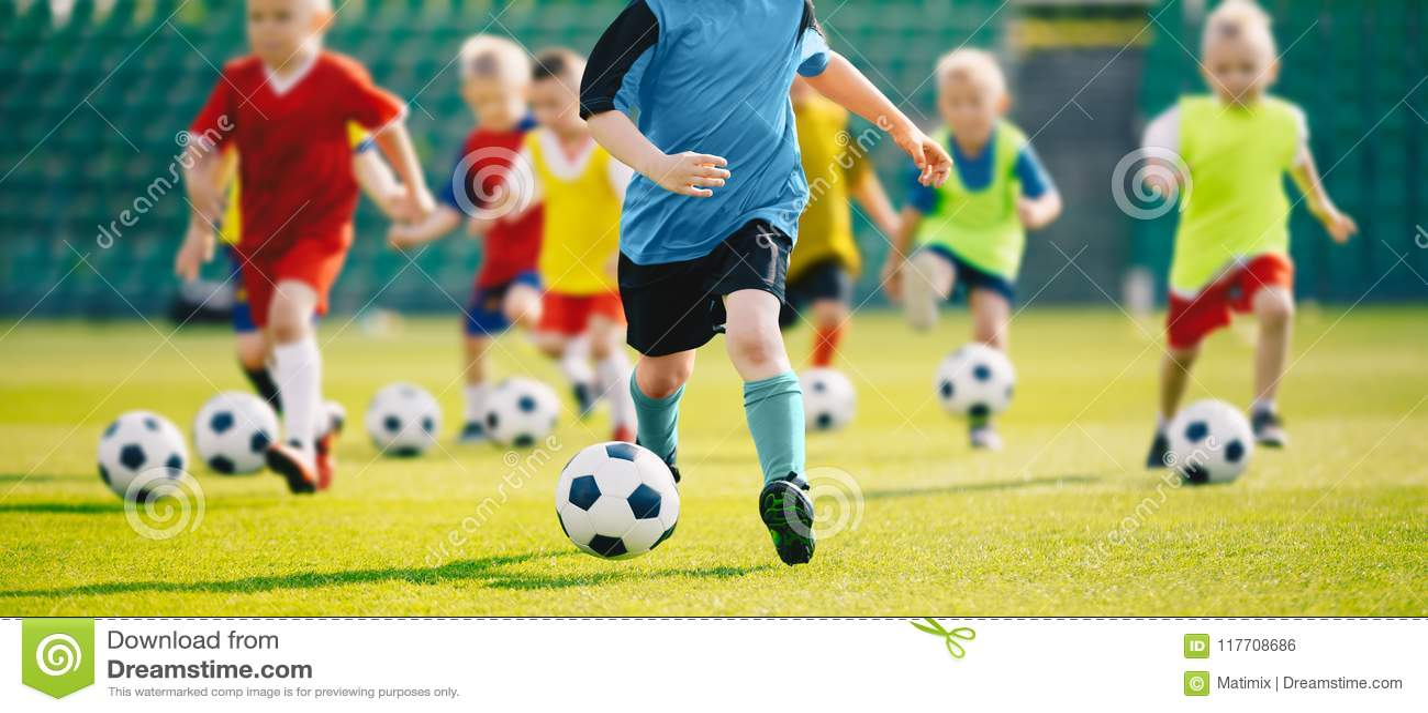Football soccer training for kids. Young boys improving soccer skills Children football training