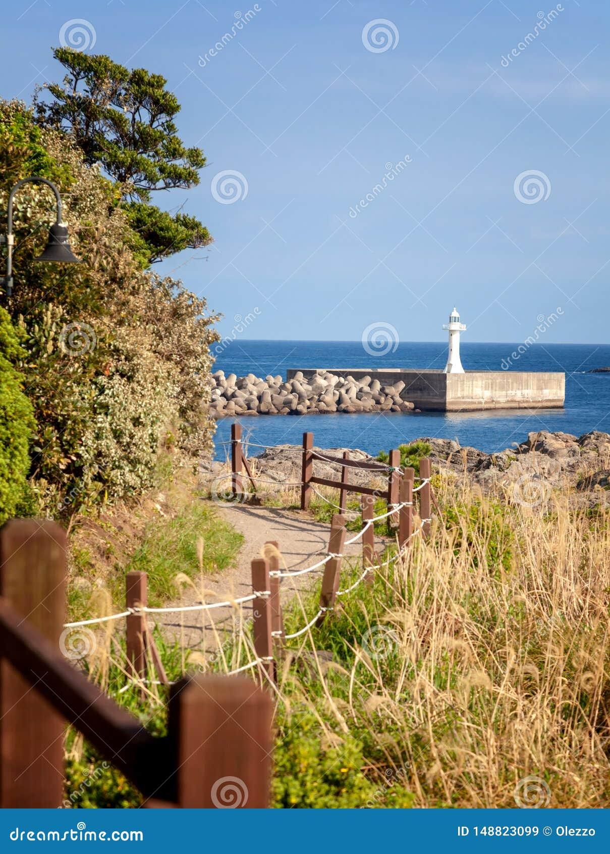 Footpath along the sea on the island of Jeju South Korea beautiful seascape. View of the lighthouse