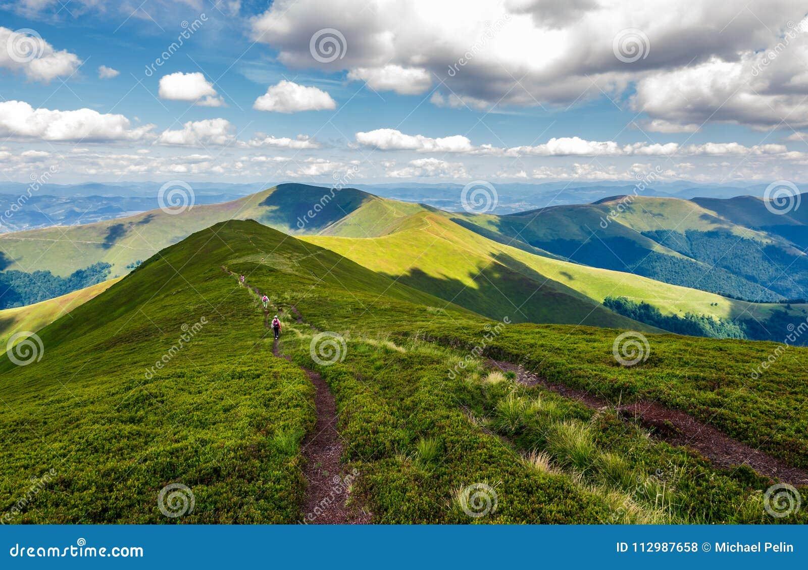 Footpath through mountain ridge in summer