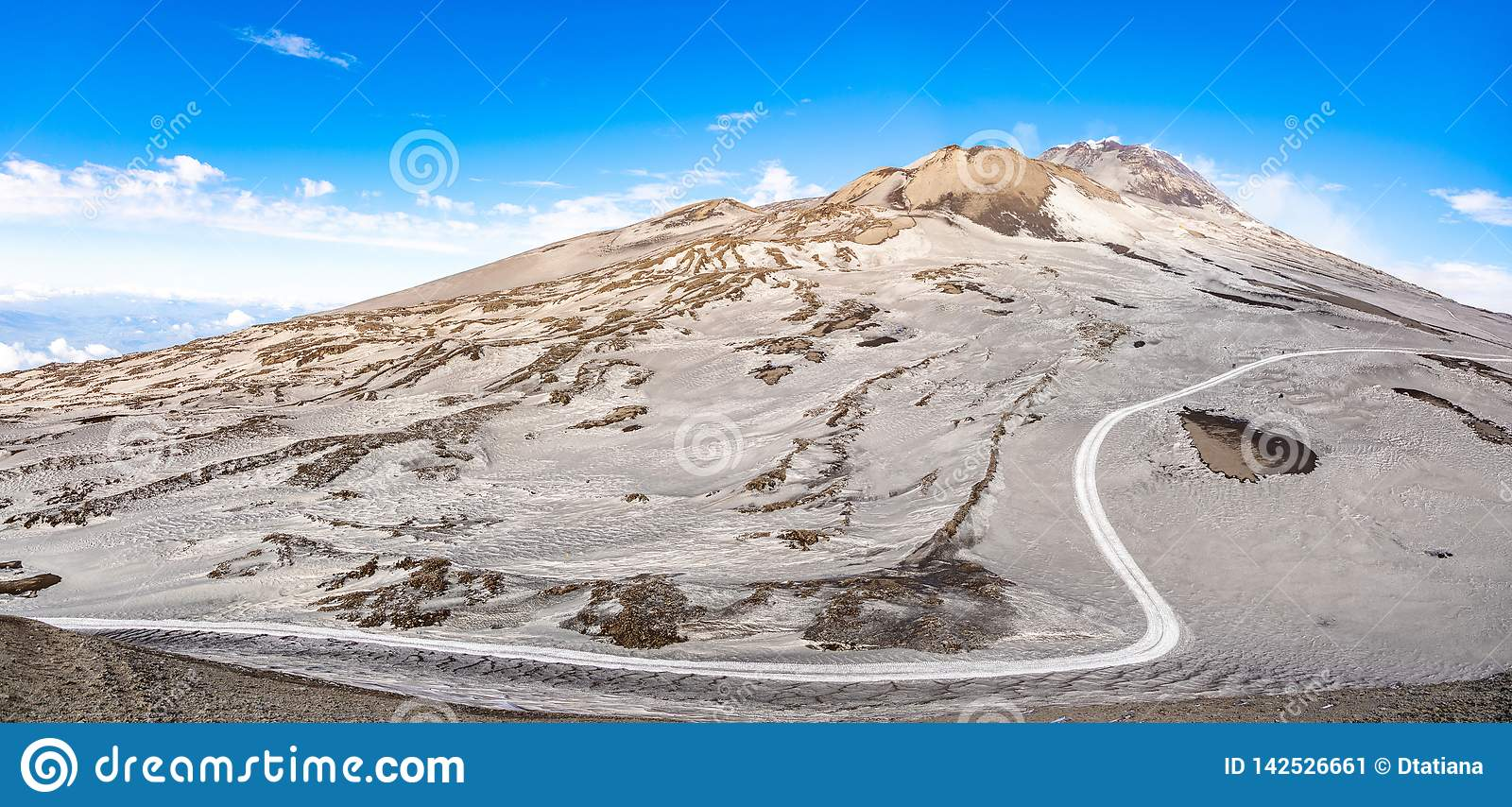 Footpath to Etna Volcano with smoke in winter, volcano landscape, Sicily island, Italy