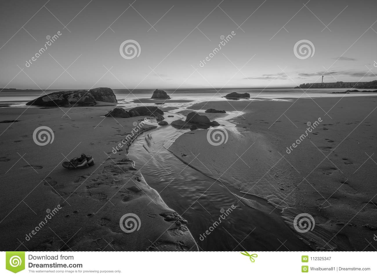 Black And White Photography Sunset On The Beach With Water Pound Rocks A Pair Of Shoes